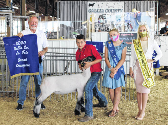 The Gallia County Jr. Fair wrapped up last week with its livestock sale, allowing local 4-H and FFA exhibitors to display their skills in the show ring and sell their animals to buyers who returned to offer their support. Pictured is Reece Toler, who sold his Grand Champion Market Lamb to Toler & Toler Insurance, representative pictured, for $20 per pound. Also pictured Gracyn Clark who sold her Reserve Champion Market Lamb to Farmers Bank, representative pictured, for $21 per pound. Also pictured Miss Gallia County Abby VanSickle and Senior Princess Sadie Cummons. More on the sale in upcoming editions and online at www.mydailytribune.com. (Dale Lear | Courtesy Photos)