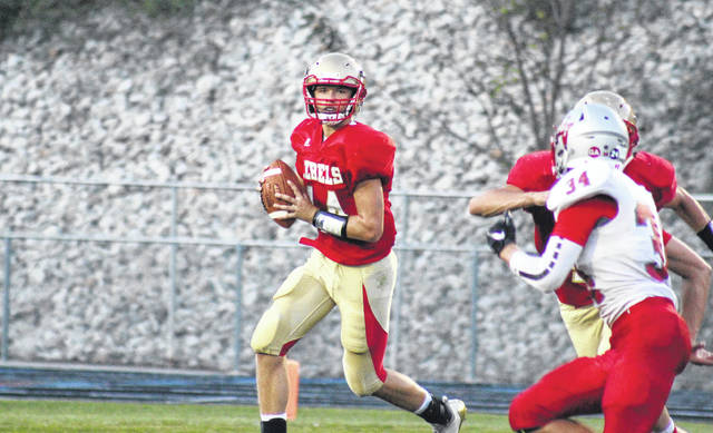 South Gallia quarterback Tristan Saber rolls out of the pocket, during the first half of the Rebels' 14-12 loss to Symmes Valley on Aug. 31, 2019, in Mercerville, Ohio.