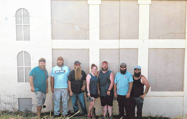 The volunteer crew from the Big Bend Beardsmen's recent community service day, pictured left to right, David Barnes, Jason Underhill, Travis Drenner, Jill Cochran, Ricky Hysell, Tyler Brewer and Trenton Brewer.