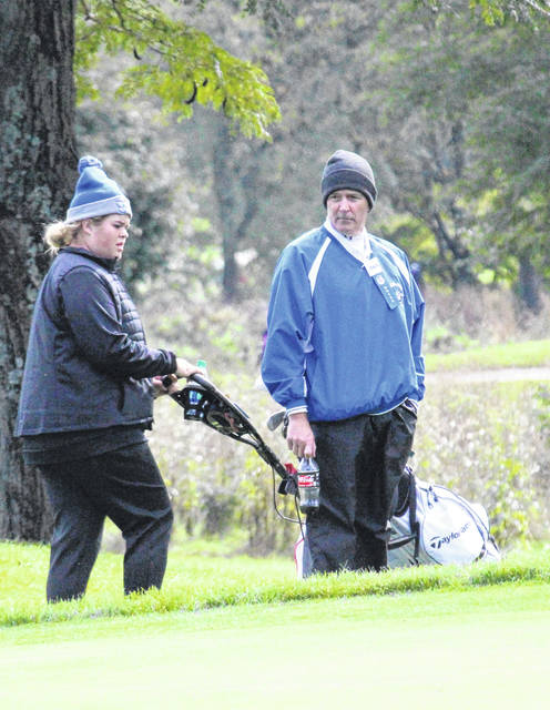 Gallia Academy golf coach Mark Allen talks with Lily Rees, during the 2018 state tournament in Columbus, Ohio.