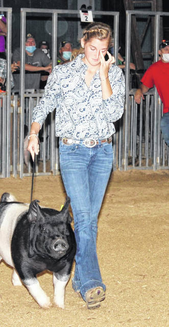 The Grand Champion Market Hog was shown by Mikenzi Pope, pictured at left, the Reserve Champion was shown by Mallory Petro, pictured at right, during this week's Gallia County Junior Fair. (Dale Lear | Courtesy Photo)