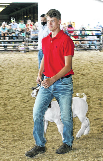 Ashton Janey, at left, took home the banner for the grand champion market goat, while Ryleigh Halley took home the prize for reserve champion at this week's Gallia County Junior Fair. (Dale Lear | Courtesy)