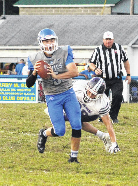 Gallia Academy junior quarterback Noah Vanco (5) avoids pressure while looking to deliver a pass during the first half of an OVC football contest against Chesapeake on Sept. 20, 2019, at Memorial Field in Gallipolis, Ohio.