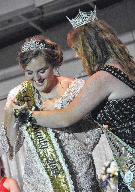 Skylar Jones-Baker, the 2019 Miss Gallia County is presented with a sash by past Miss Gallia Jamie Steger at last year's Gallia County Jr. Fair. Jones-Baker gave up her title on Monday. (OVP File Photo)