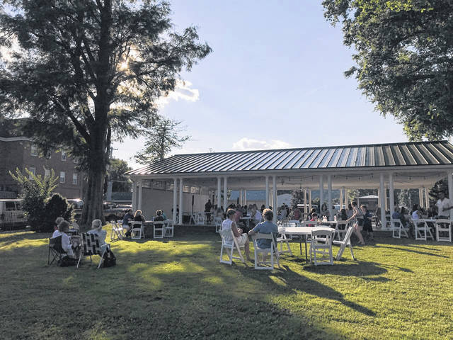 The lawn and outdoor pavilion at the French Art Colony's home on First Avenue allows for socially-distant space and events. Pictured is an activity from earlier this summer. (Beth Sergent | OVP)