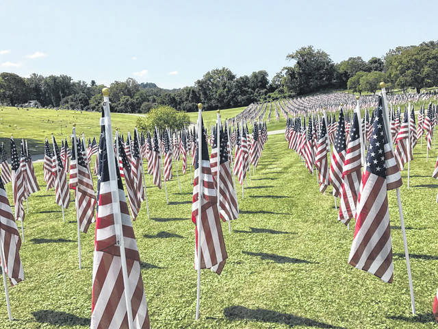 The Healing Field at Spring Hill Cemetery in Huntington, W.Va. serves as a patriotic vigil to the thousands of victims of the 9/11 tragedy, recognizes the lives lost in the 1970 Marshall Plane Crash, memorializes Veterans of the Armed Forces and lost loved ones. (Beth Sergent | OVP)
