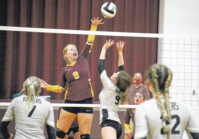 Meigs' Meredith Cremeans spikes the ball over a block attempt from River Valley's Jaden Bradley, during Tuesday's TVC Ohio volleyball match in Rocksprings, Ohio.