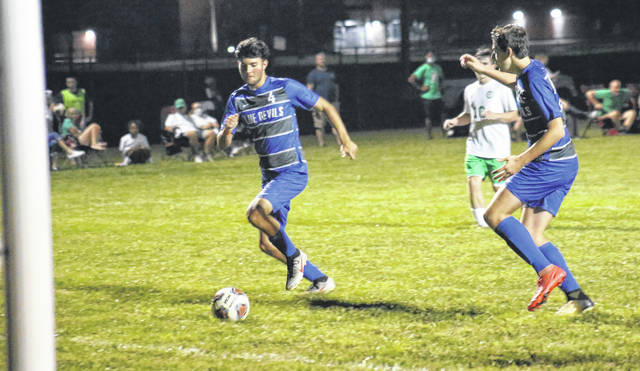 GAHS senior Christian Higginbotham (4) scores on an assist from Brody Wilt (right), during the second half of the Blue Devils' 8-0 victory over Fairland on Thursday in Centenary, Ohio.