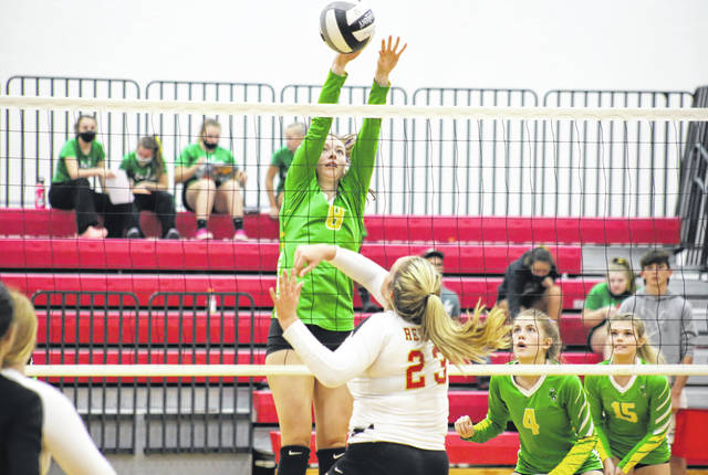 Eastern senior Olivia Barber (8) blocks a SGHS spike attempt, during the Lady Eagles' 3-0 win on Thursday in Mercerville, Ohio.