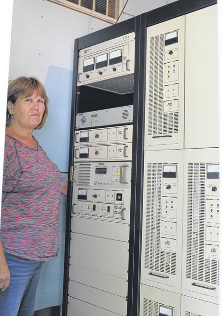 Brenda Barnhart is pictured with some of the equipment which is used for WJOS.