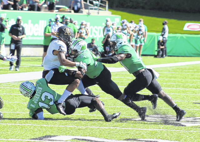 Appalachian State receiver Jalen Virgil is gang-tackled by Marshall defenders Nazeeh Johnson (13), Eli Neal (24) and Abraham Beauplan during the first quarter of Saturday's 17-7 Thundering Herd victory at Joan C. Edwards Stadium in Huntington, W.Va.