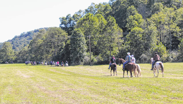 Riders head out on the trail for the annual St. Jude Trail Ride at the Dill Farm.