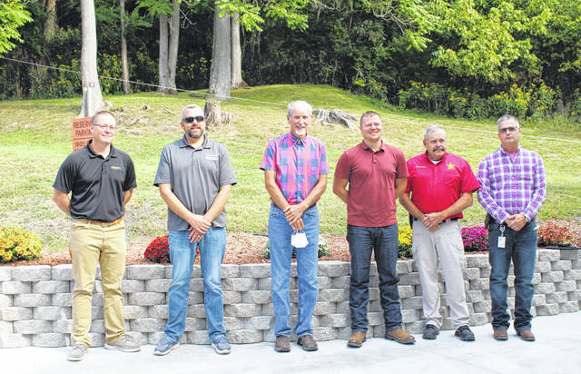 Pictured from left are Meigs County 911 and EMS Director Robbie Jacks, Commissioners Randy Smith, Tim Ihle, Jimmy Will, Sheriff Keith Wood and Jamie Jones from Meigs County EMA. (Sarah Hawley | Sentinel)