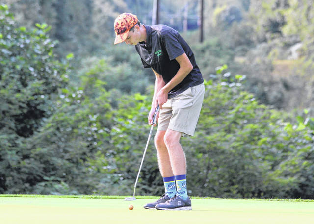 Eastern junior Colton McDaniel hits a putt attempt during a Sept. 15 golf match at Meigs Golf Course in Pomeroy, Ohio.
