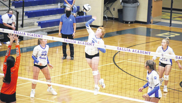 Gallia Academy's Maddi Meadows (3) spikes the ball over the net, during the Blue Angels' straight games win over Ironton on Tuesday in Centenary, Ohio.