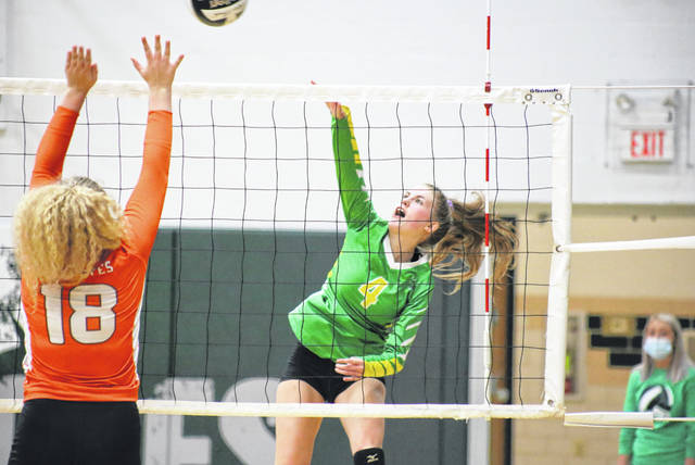 Eastern senior Jenna Chadwell (4) spikes the ball over an NYHS block attempt, during Monday's non-conference match in Tuppers Plains, Ohio.