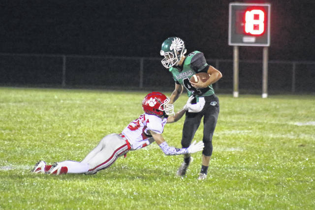 Eastern junior Brayden Smith (4) fights of a Tomcat defender, after one of his game-best five receptions, during the Eagles' 10-7 setback on Friday in Tuppers Plains, Ohio. (Alex Hawley|OVP Sports)