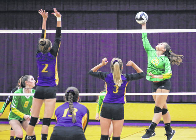 Eastern sophomore Megan Maxon, right, hits a spike attempt during Thursday night's TVC Hocking volleyball contest against Southern in Racine, Ohio.