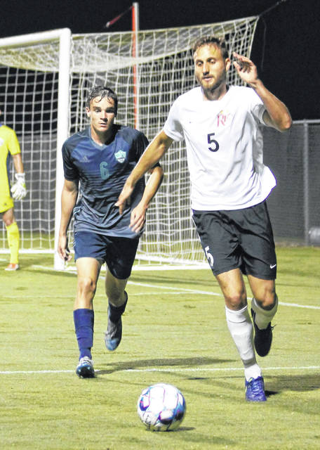 Rio Grande's Silas Machado beats Mount Vernon Nazarene's Ryan Walters to the ball in Wednesday's night game at Evan E. Davis Field. Machado assisted on the tying goal and scored the winning marker in the RedStorm's 2-1 victory over the Cougars.