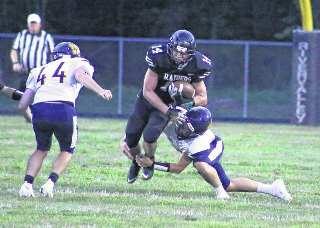 River Valley junior Ryan Jones (14) carries the ball for yardage during a Week 1 football contest against Wellston in Bidwell, Ohio.