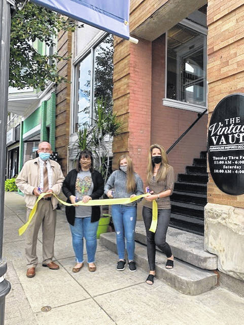 A new business opened downtown in Point Pleasant on Friday. The Vintage Vault, at 500 Main Street, has farmhouse home decor, furniture, chalk paint, candles, linens and floral items. The store is open Tuesday-Friday from 11 a.m.-6 p.m. and Saturday from 10 a.m.-4 p.m. It will be closed on Sundays and Mondays. Pictured from left are Mayor Brian Billings, owner Amanda Stanley, her daughter Olivia Stanley and City Clerk Amber Tatterson.