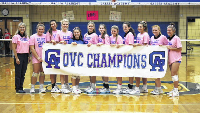 Members of the GAHS volleyball team pose for a photo after their first home match since clinching the program's sixth straight Ohio Valley Conference championship.