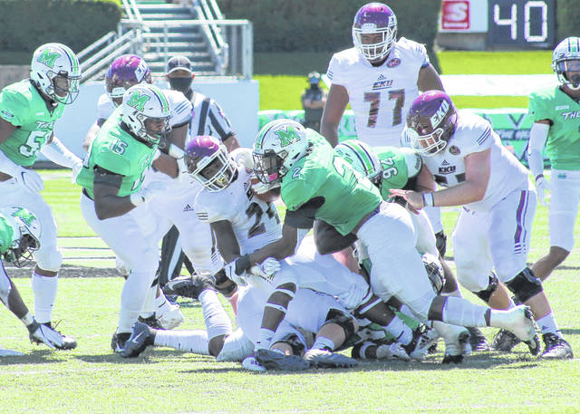 Marshall defensive end Darius Hodge (2) takes down an Eastern Kentucky ball carrier during the first quarter of a Sept. 5 football game at Joan C. Edwards Stadium in Huntington, W.Va.