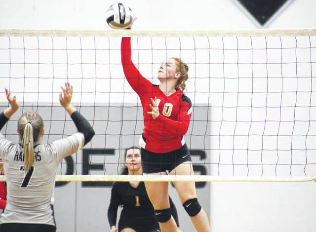 South Gallia senior Bella Cochran (10) spikes the ball in front of teammate Ellen Weaver (1), during the Lady Rebels' Aug. 31 match in Bidwell, Ohio.