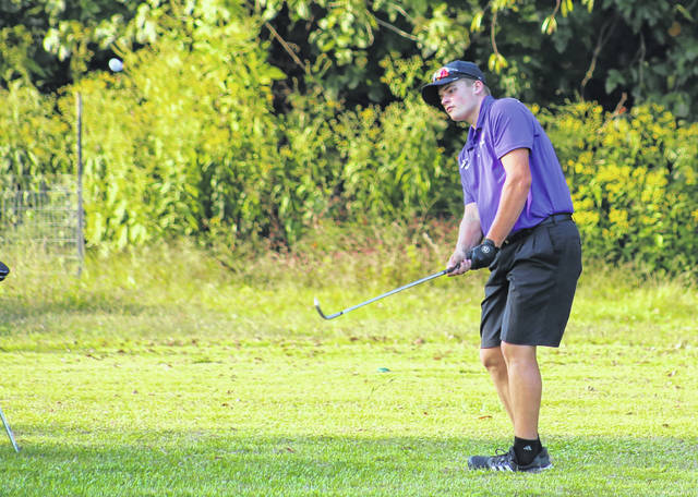 Southern senior Jacob Milliron hits a chip shot onto the ninth green during a Sept. 22 golf match at Riverside Golf Course in Mason, W.Va.