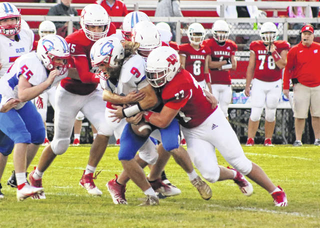 Wahama sophomore Trey Ohlinger (77) jars the ball loose during a first quarter tackle against Gilmer County during a Sept. 18 football contest at Bachtel Stadium in Mason, W.Va.