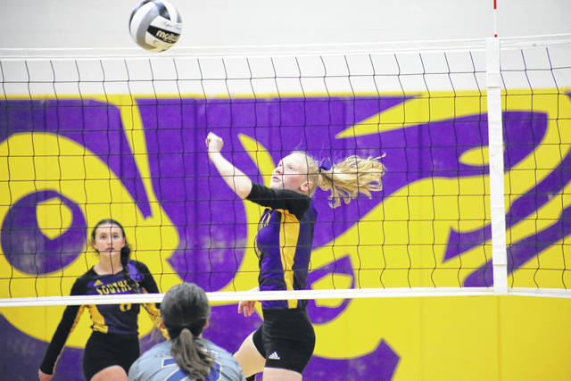 Southern junior Kayla Evans spikes the ball over the net, during the Lady Tornadoes' 3-2 sectional semifinal victory on Monday in Racine, Ohio.