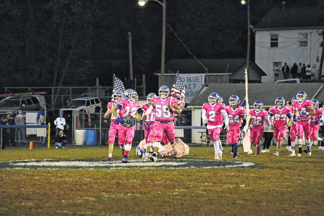 The Gallia Academy Blue Devils recently showed its support for Breast Cancer Awareness Month by dressing in pink uniforms during Saturday's 46-8 victory over visiting Vinton County in a Division IV, Region 15 second round playoff contest at Memorial Field in Gallia County. GAHS will be headed to Byesville on Saturday to face fourth seeded Meadowbrook in a Region 15 quarterfinal at 7 p.m. Ohio Valley Publishing's annual Breast Cancer Awareness special edition, full of stories of survival, and helpful hints for staying healthy, will be available on Friday. (Bryan Walters | OVP)