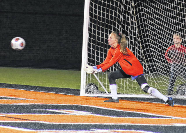 Gallia Academy junior Alivia Lear makes a save in goal during the second half of Tuesday night's Division II girls soccer sectional contest against Waverly at Raidiger Field in Waverly, Ohio.