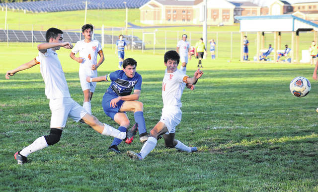 GAHS junior Brody Wilt (26) scores is second of three goals, during the Blue Devils' 7-1 sectional championship victory on Thursday in Centenary, Ohio.