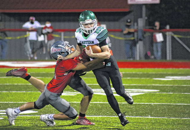 Eastern junior Colton Combs (25) drags a pair of Pilots for extra yardage, during River's 49-13 victory on Friday in Hannibal, Ohio.