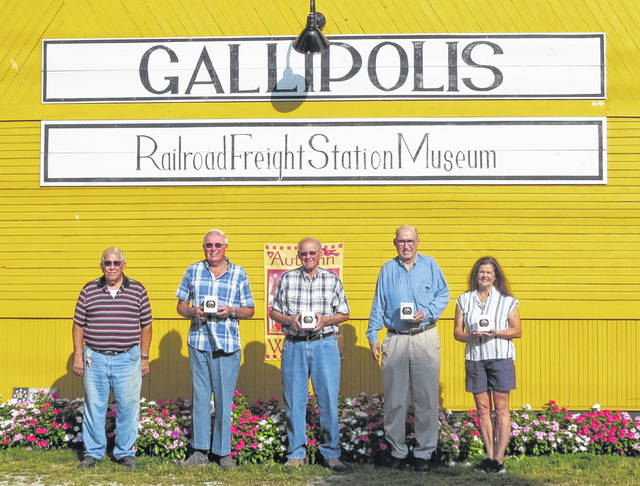 "Pictured with their landmark bulbs are the Gallipolis Frieght Museum Board Members Eugene Haberstich, Jerry Davis, Jim Love, William ""Bill"" Thomas, Helenlu Morgan. (Courtesy)"