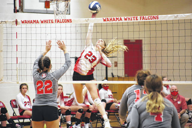 Wahama senior Chloe Oldaker (23) spikes the ball over the net, during the Lady Falcons sweep of Poca on Thursday in Mason, W.Va.