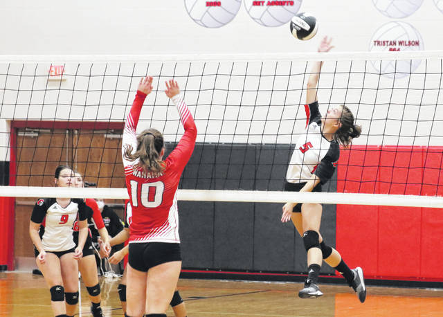 Point Pleasant junior Brooke Warner (5) leaps for a spike attempt during Tuesday night's volleyball match against Wahama in Point Pleasant, W.Va.