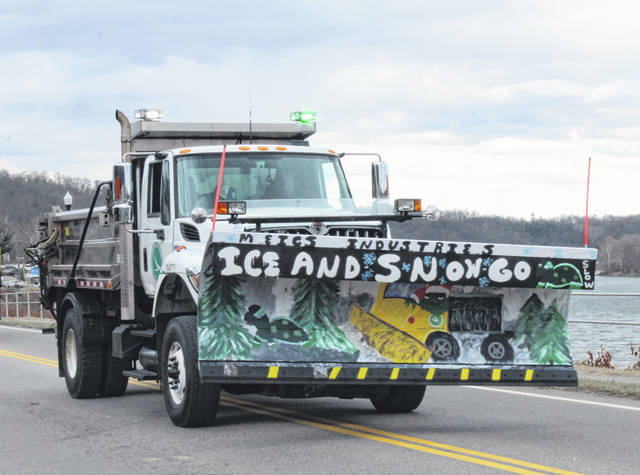 Snow plows will soon be on the roadways clearing ice and snow as winter arrives. The Meigs ODOT garage painted plows and took part in last year's Pomeroy Christmas Parade, pictured.