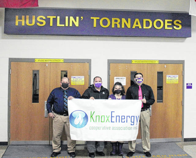 Knox Energy based in Canton, Ohio recently made a $5,000 donation to the Southern Local School District's Athletic Department. Pictured here holding the Knox banner are (left to right) Scott Wolfe, Grants Administrator and Fundraising Organizer; Tony Deem, Superintendent; Tricia McNickle, Elementary Principal; and Daniel Otto, High School Principal. Knox Energy, under the management of Utility Pipeline Ltd. (UPL) has successfully brought multiple gas service to more than 22,000 residential and commercial customers throughout Ohio and Pennsylvania. Knox provides Gas Service to Racine and Southern Local. Because of the COVID-19 Pandemic, crowds at sporting events have been limited to parents, thus gate receipts have been practically non-existent and over time will put the athletic program in a financial bind. Part of the fundraising plan includes getting AED defibulators for all of the athletic facilities at Southern. Donations are still being sought as part of the athletic department campaign at Southern Local Athletics Donations, Attn: Scott Wolfe; 920 Elm Street, Racine, Ohio 45771. (Southern Local | Courtesy photo)