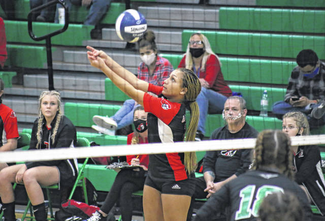 PPHS sophomore Kierra Smith sends the ball over the net, during the Class AA Region IV championship match on Saturday night in Winfield, W.Va.