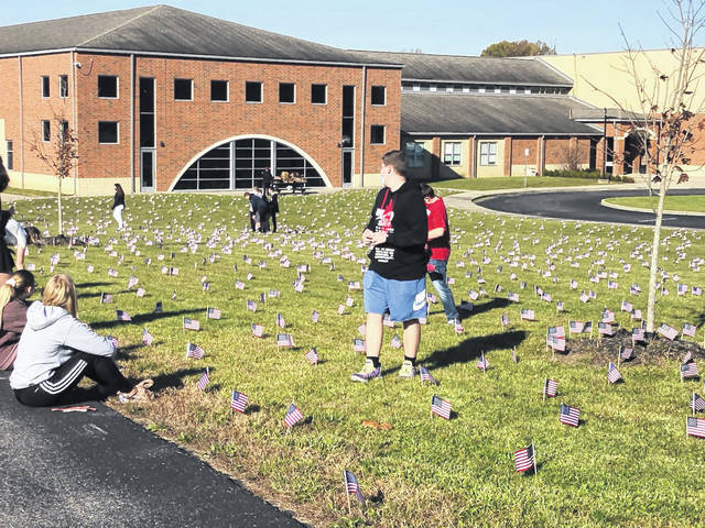 Students at River Valley High School placed 2,997 flags as part of the Healing Field display at the school.
