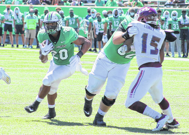 Marshall running back Brenden Knox (20) finds a hole to run through during the first quarter of a Sept. 5 football game against Eastern Kentucky at Joan C. Edwards Stadium in Huntington, W.Va.