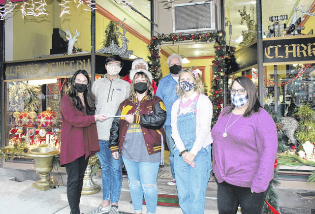 Clark's Jewelry of Pomeroy recently made a donation to the Meigs High School Student Council to be used for the purchase of gifts for the Angel Tree project. Each year the student council conducts fundraising to purchase gifts, with COVID-19 restrictions limiting those efforts. Advisor Abby Harris noted that the donation from Clark's will allow the project to continue and expand from past years. Pictured are Susan Clark and Toney Dingess from Clark's Jewelry, Student Council members Cameron Davis, Jack Musser and Claire Howard, and Advisor Abby Harris.