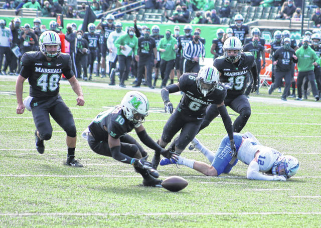 Marshall junior Joshua Bowers (10) goes to a scoop up a fumble caused by a hit from teammate Micah Abraham (6) during the first quarter of Saturday's Conference USA football game against Middle Tennessee State at Joan C. Edwards Stadium in Huntington, W.Va.