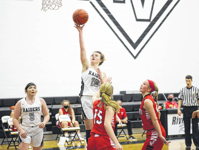 River Valley sophomore Madison Hall tries a two-point shot in front of teammate Allie Holey (5), during the Lady Raiders 52-47 setback on Friday in Bidwell, Ohio.