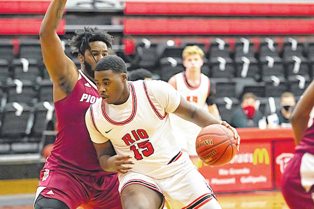 Rio Grande's Bryanth Farr makes a move toward the basket on Campbellsville-Harrodsburg's Aamaj Platt during Saturday's 79-58 win over the Pioneers at the Newt Oliver Arena.