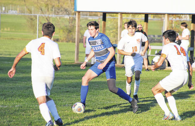 Gallia Academy junior Brody Wilt (26) evades a trio of Portsmouth West defenders, during the Blue Devils' Oct. 22 victory on Lester Field in Centenary, Ohio.