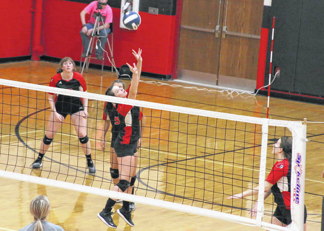 Point Pleasant junior Baylie Rickard, middle, sets up a spike attempt during Wednesday night's Class AA Region IV, Section 1 semifinal against Poca in Point Pleasant, W.Va.