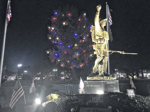 The Gallipolis In Lights group of volunteers recently decorated a patriotic tree located near the Spirit of the American Doughboy Memorial in Gallipolis City Park, in honor of the presidential election and as a tribute to veterans. (Beth Sergent | OVP)